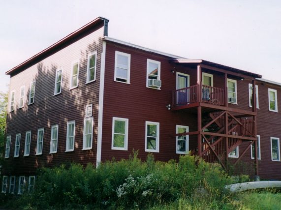 Dorset multi-unit apartment buildingpainted by Eddie Charbonneau Painting