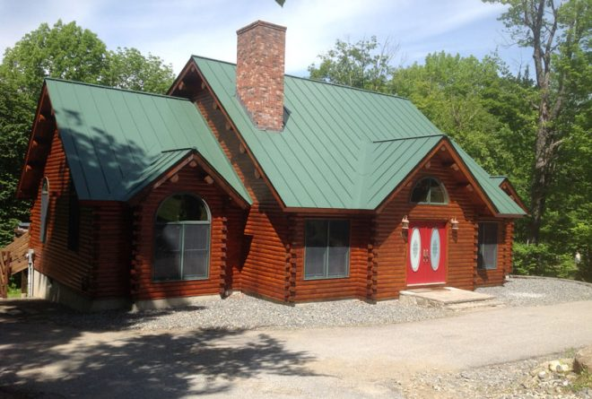 Winhall log cabin stained and finished by Eddie Charbonneau Painting